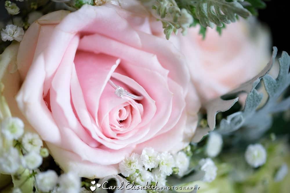 Wedding ring in a pink rose