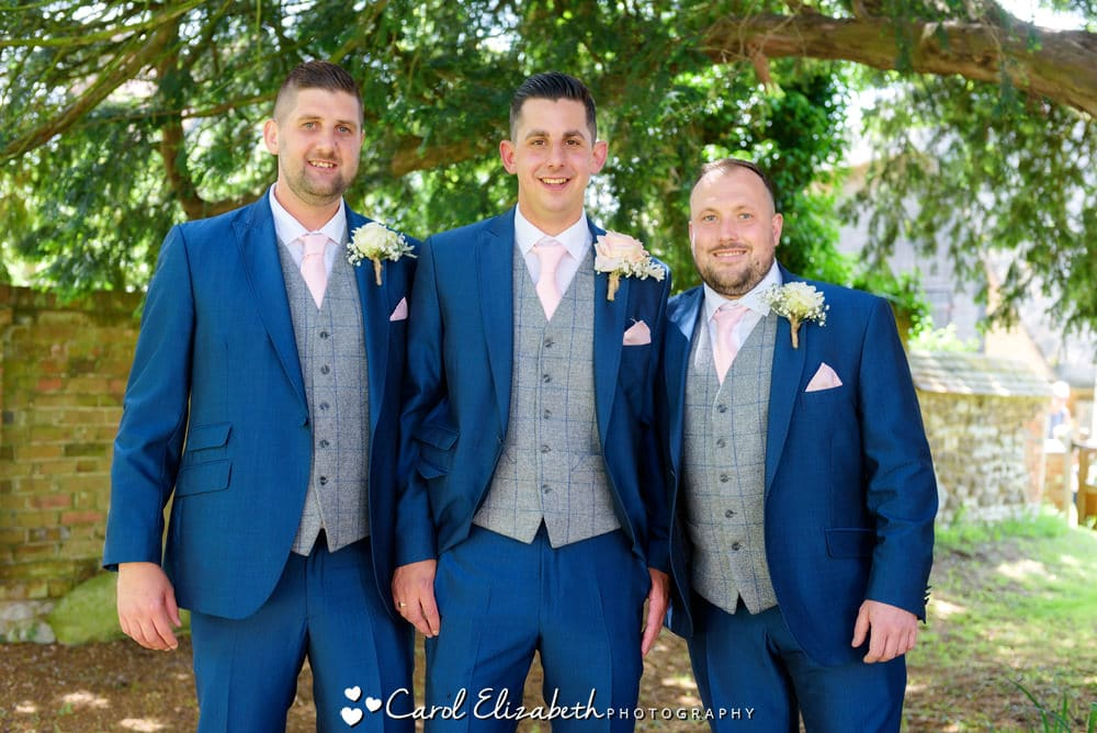 Groom and ushers before the wedding in blue suits