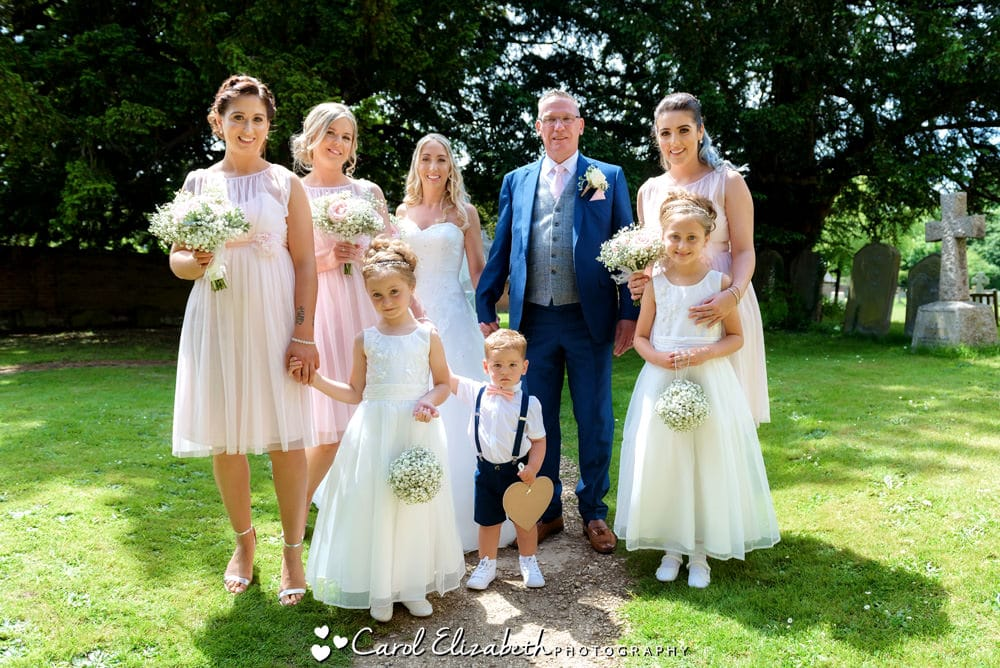 The bridal party at a summer wedding in Oxfordshire