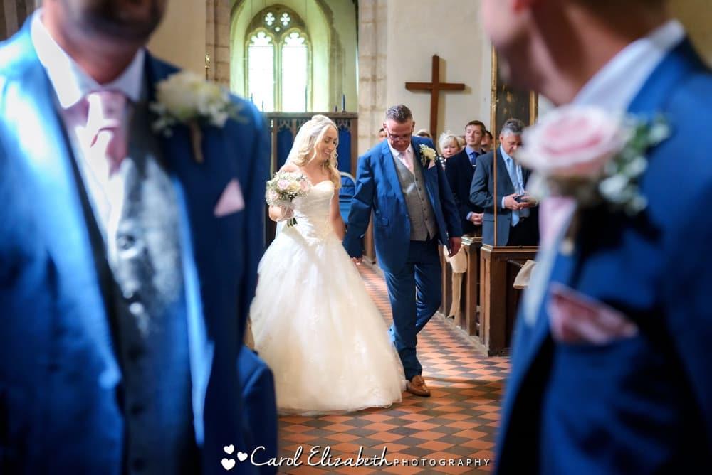 Bride and her dad entering Oxfordshire wedding ceremony