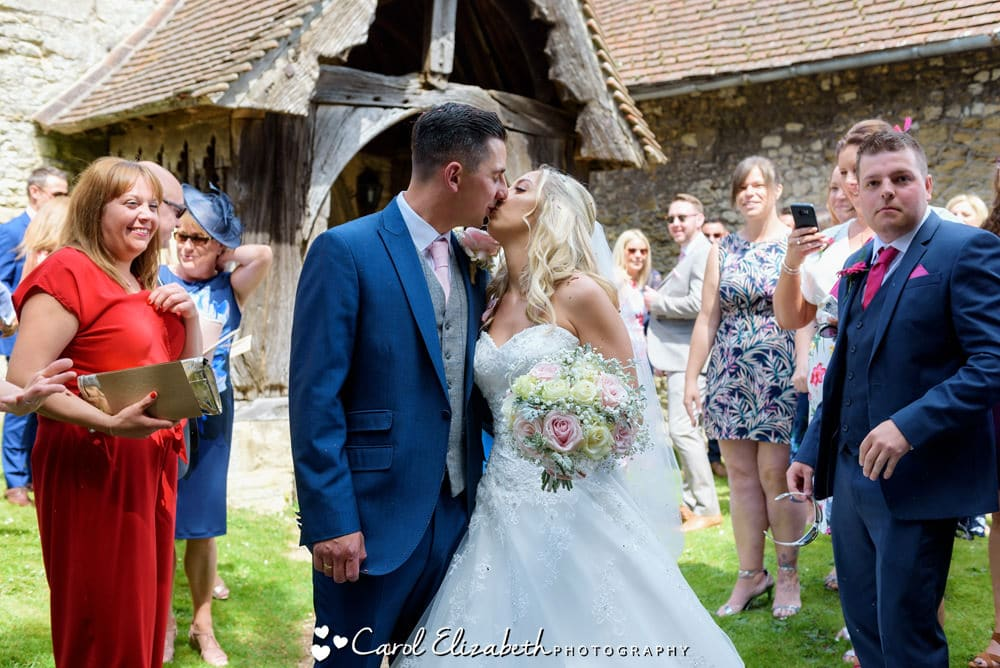 Wedding kiss at Long Wittenham Church in Oxfordshire