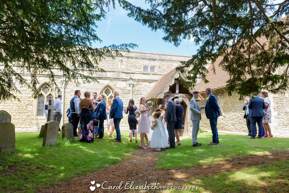 Guests outside St Mary the Virgin Church in Long Wittenham