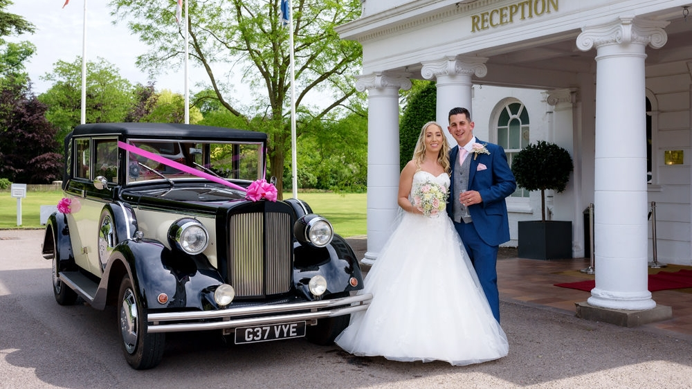 Bride and groom with vintage wedding car at Milton Hill House wedding