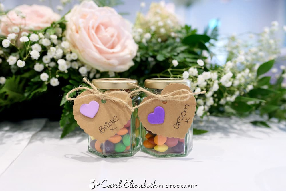 Bride and groom wedding favours with smarties in glass jars