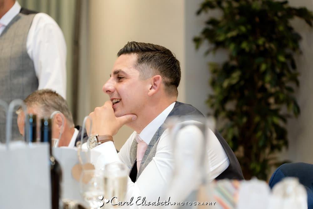 Groom watching Milton Hill wedding speeches