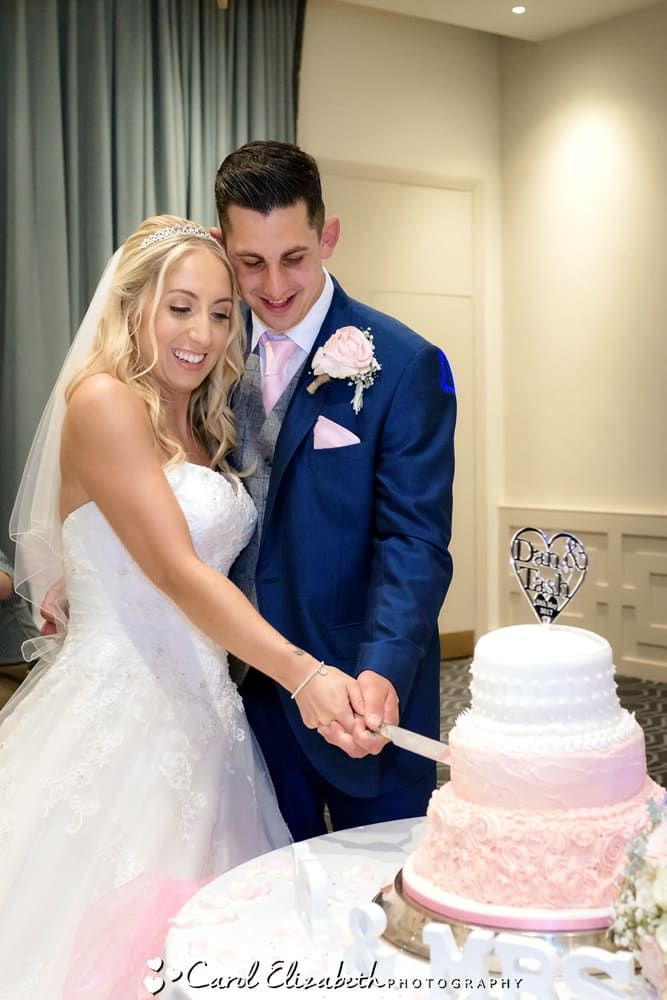 Cutting the wedding cake at Milton Hill House wedding reception