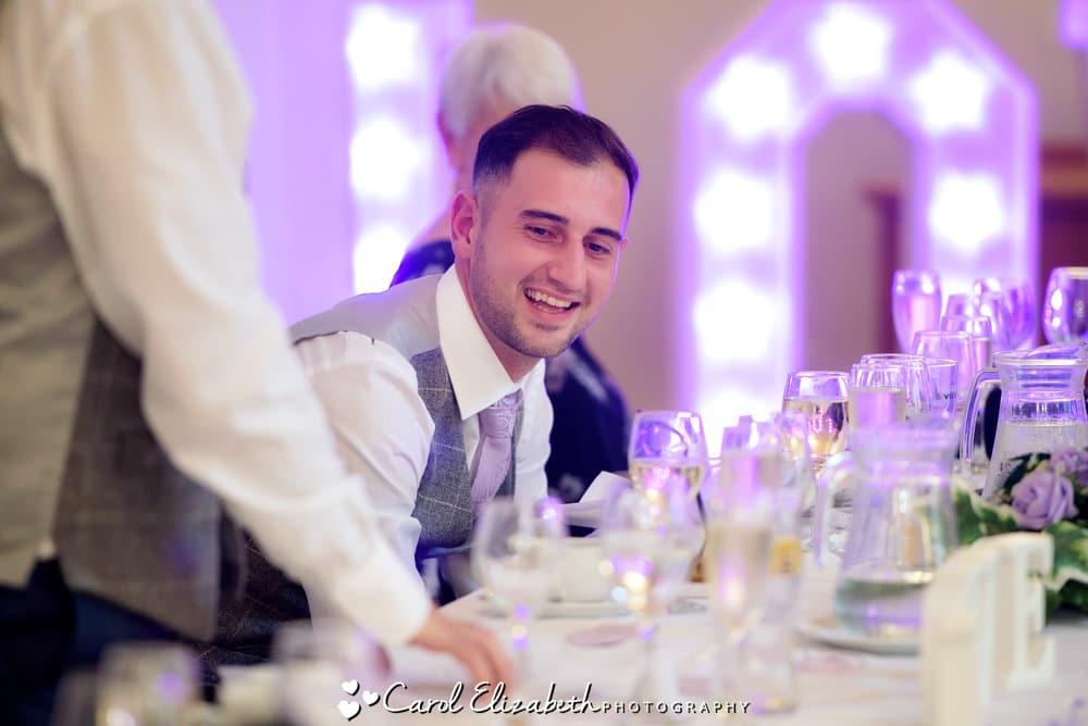 Groom watching wedding speeches
