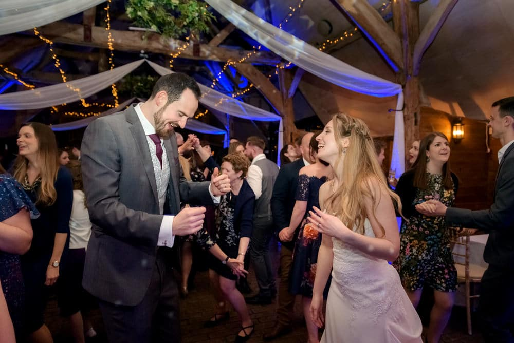 Bride and groom dancing at Lains Barn reception