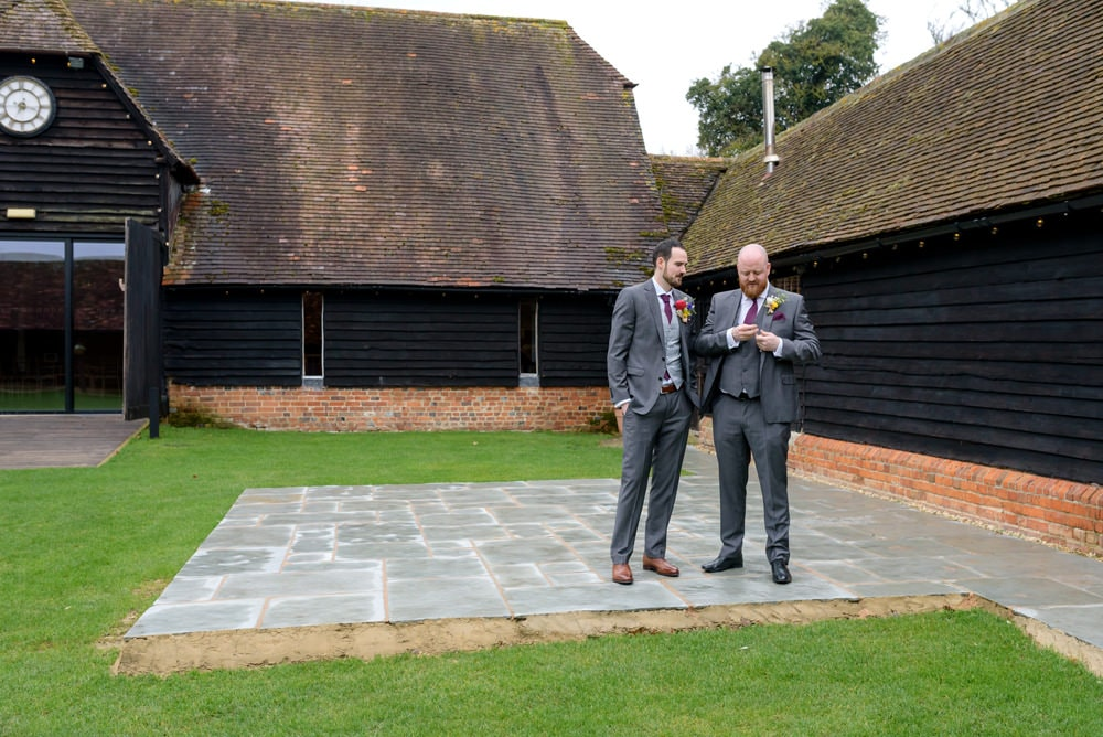 Groom outside Lains Barn wedding