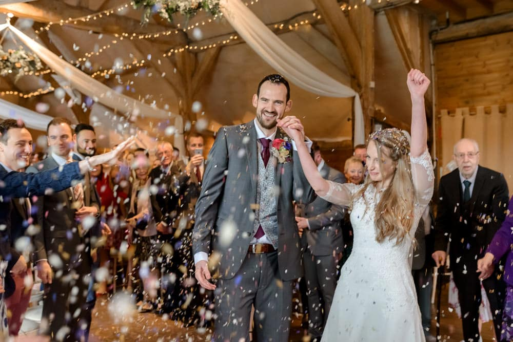 Indoors wedding confetti at Lains Barn