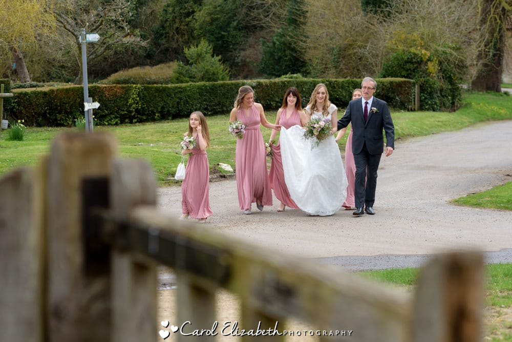 Bride walking to Nether Winchendon church wedding