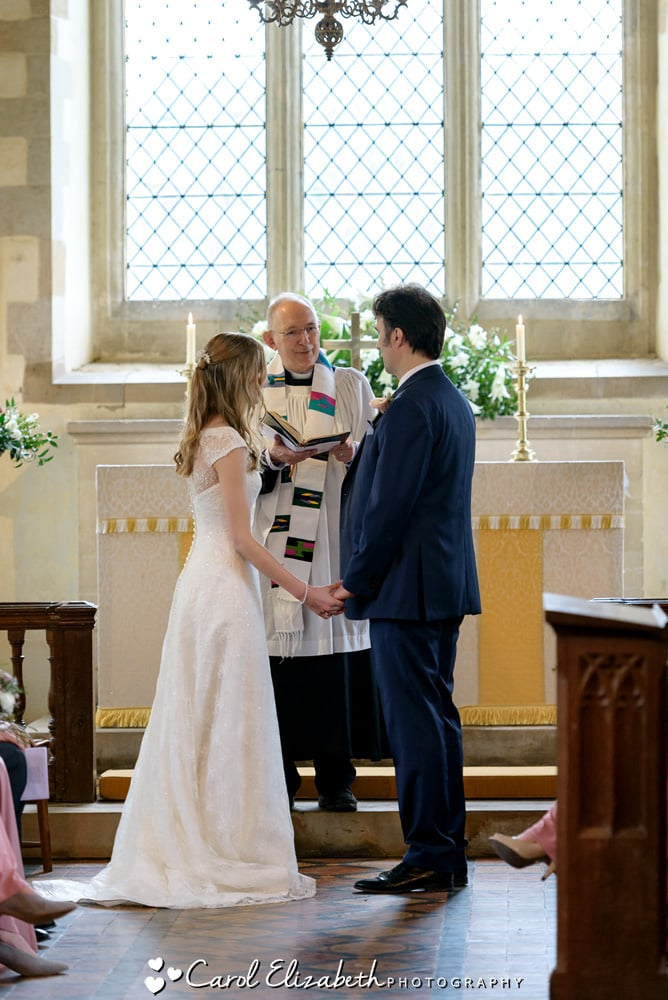 Bride and groom during the wedding ceremony at Nether Winchendon Church