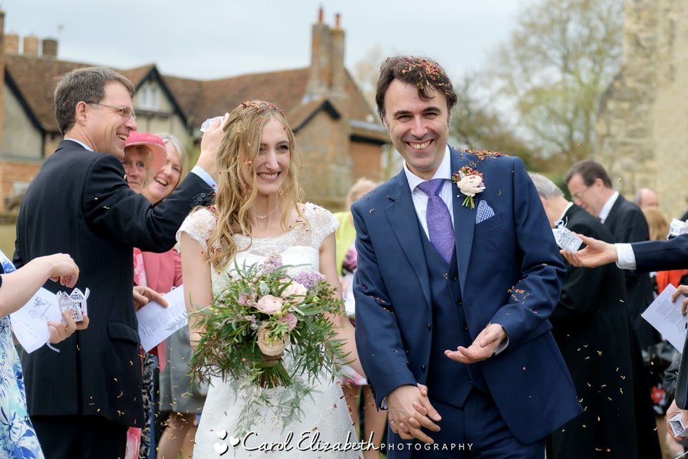 Nether Winchendon House and Church wedding photographer - bride and groom with confetti