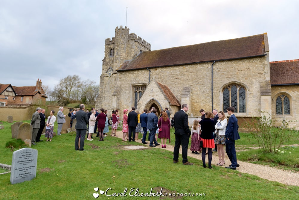 Guests outside Nether Winchendon church wedding
