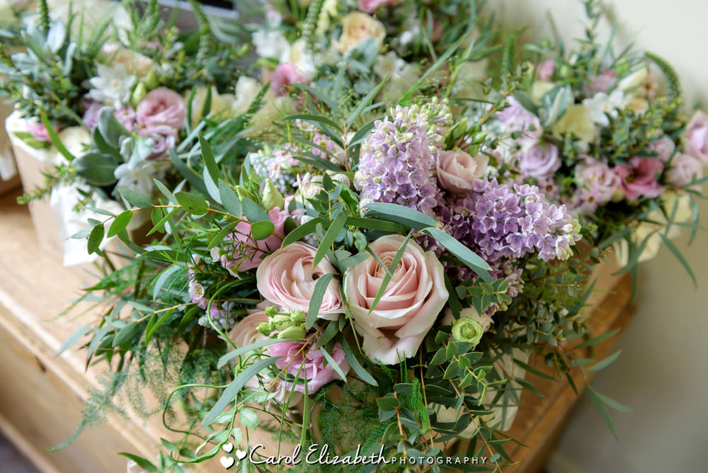 Wedding bouquets of roses by Herbert and Isles