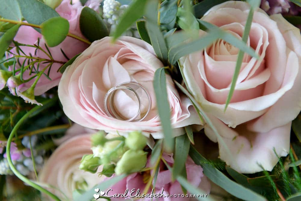 Wedding rings in Roses - wedding flowers by Herbert and Isles