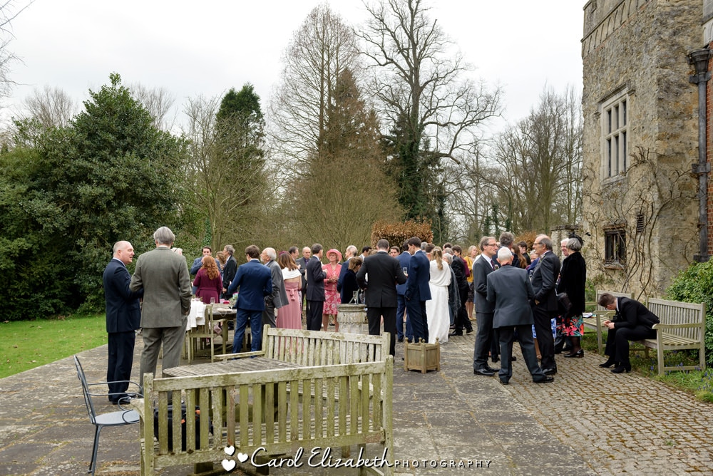 Wedding guests on the terrace at Nether Winchendon House