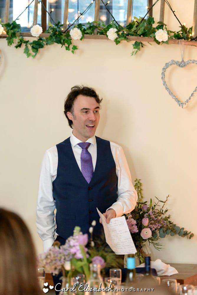 Groom giving a speech during wedding reception