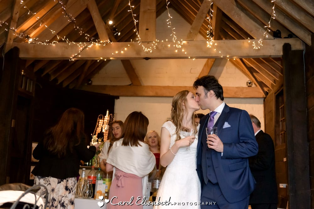 Evening bride and groom kissing after wedding