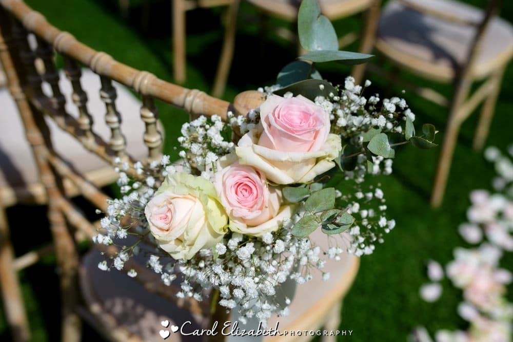 Pink roses on wooden chairs