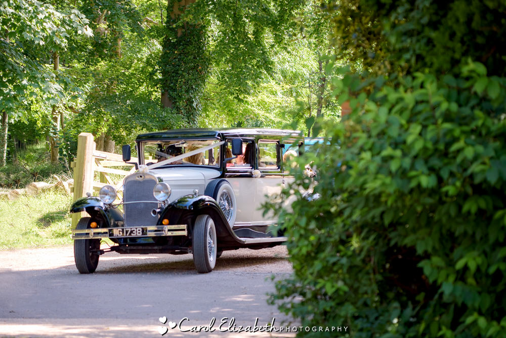 Vintage wedding car arriving