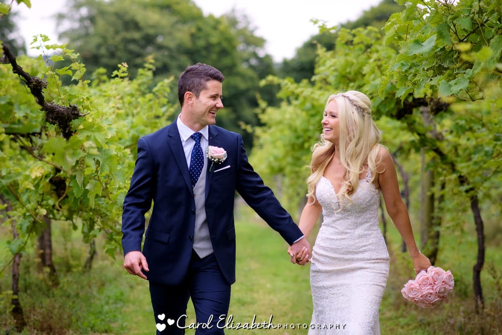Old Luxters Barn natural wedding photography - bride and groom in the vineyard