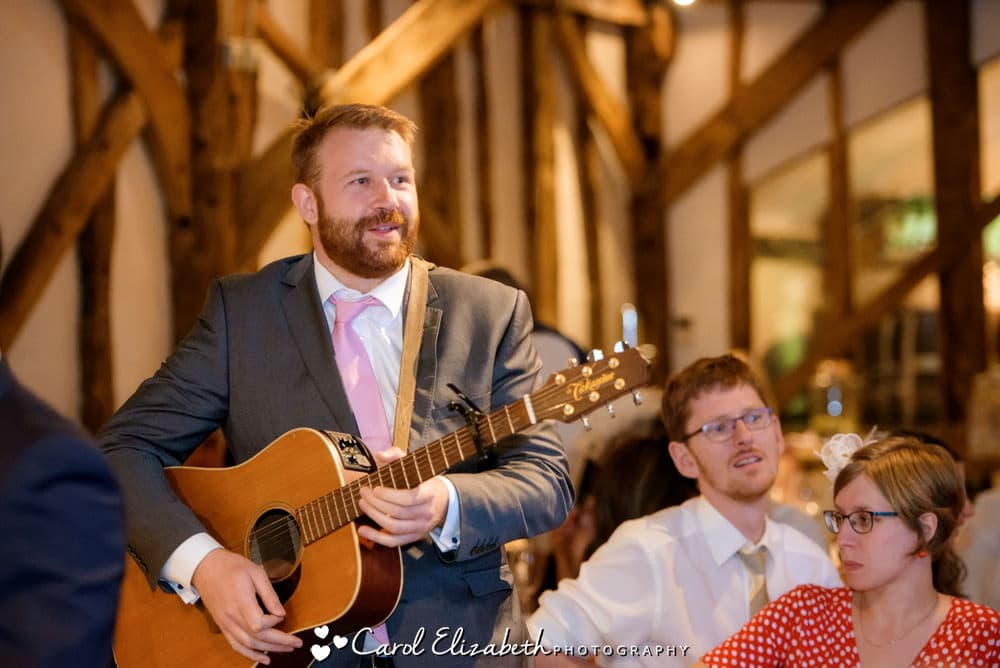 Guest playing guitar during speeches