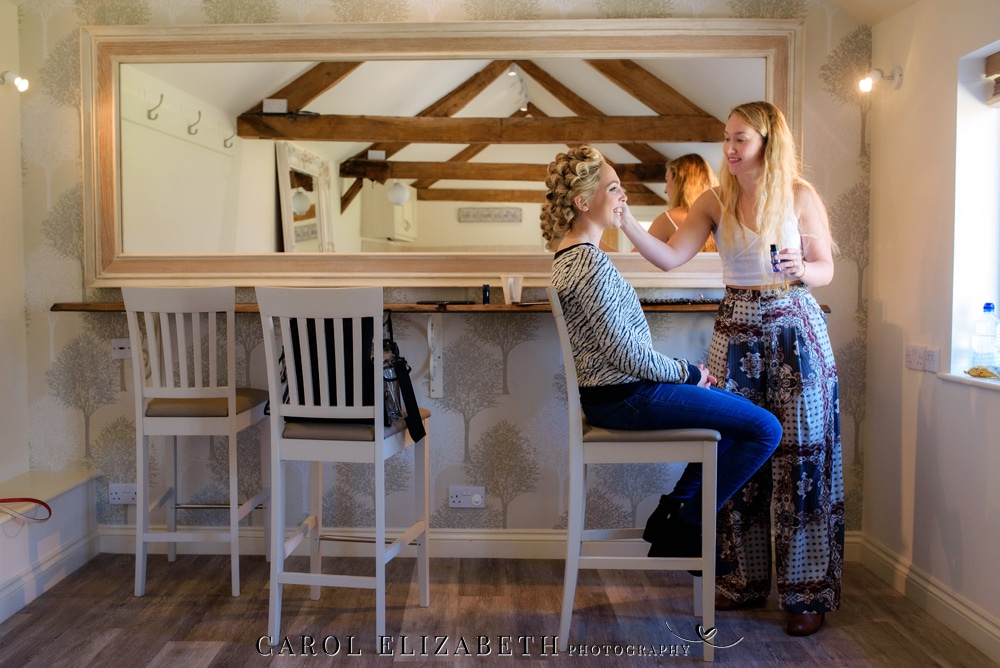 Bridal make-up preparations at Caswell House wedding