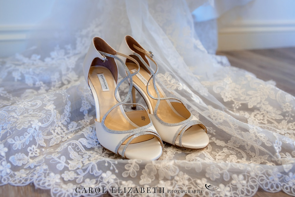 Wedding shoes on lace dress
