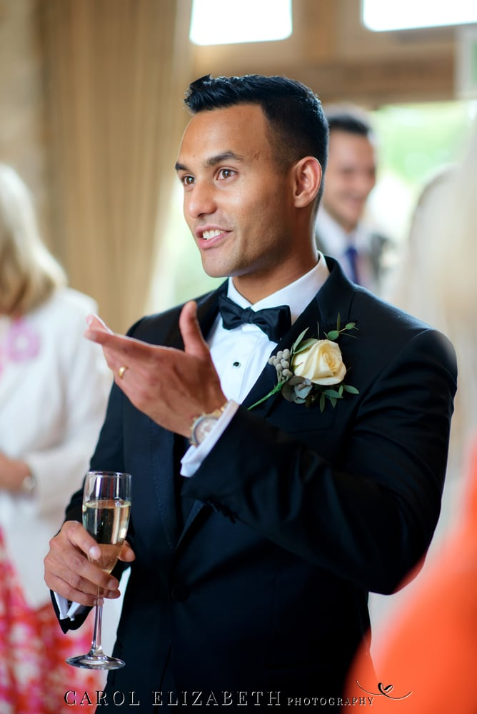 Groom chatting to guests