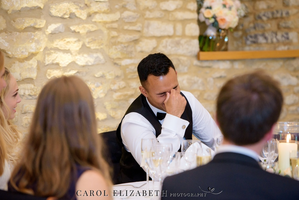 Groom watching wedding speeches