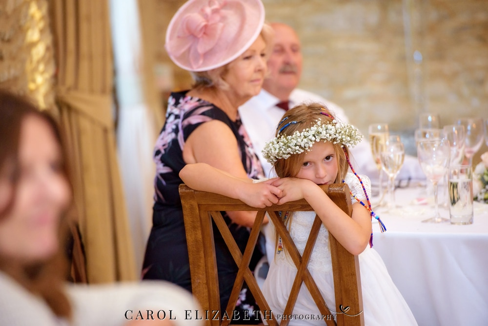 Bridesmaid watching wedding speeches - candid wedding moments