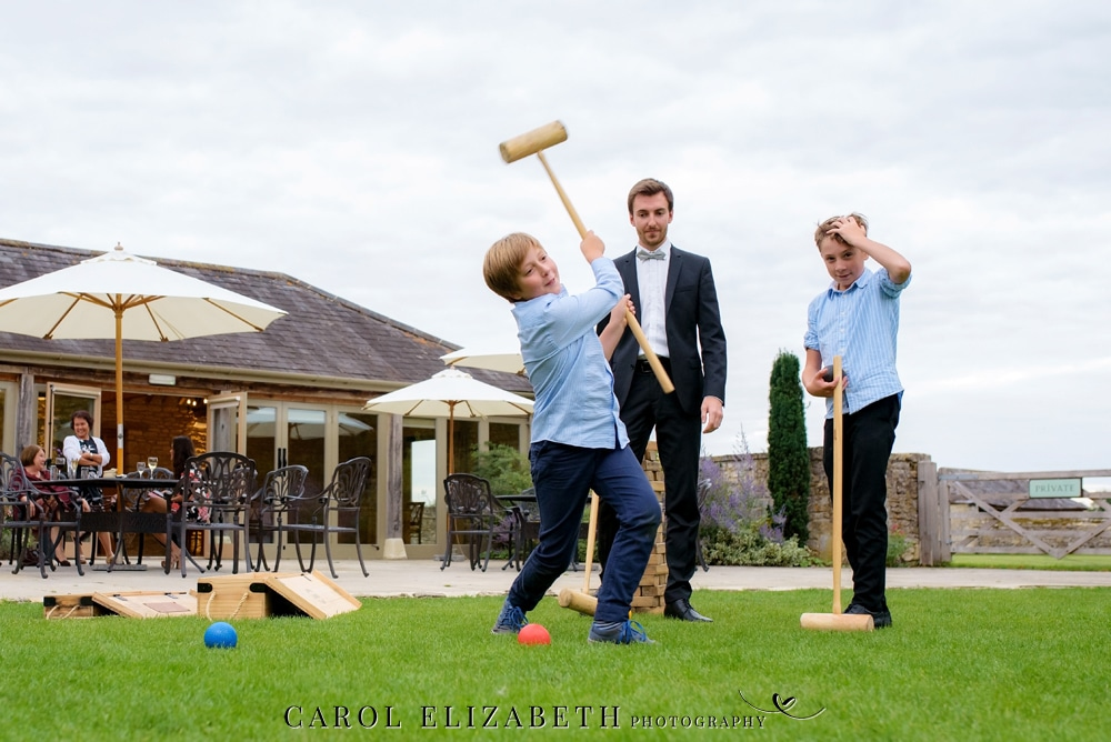 Playing lawn games at Caswell House wedding