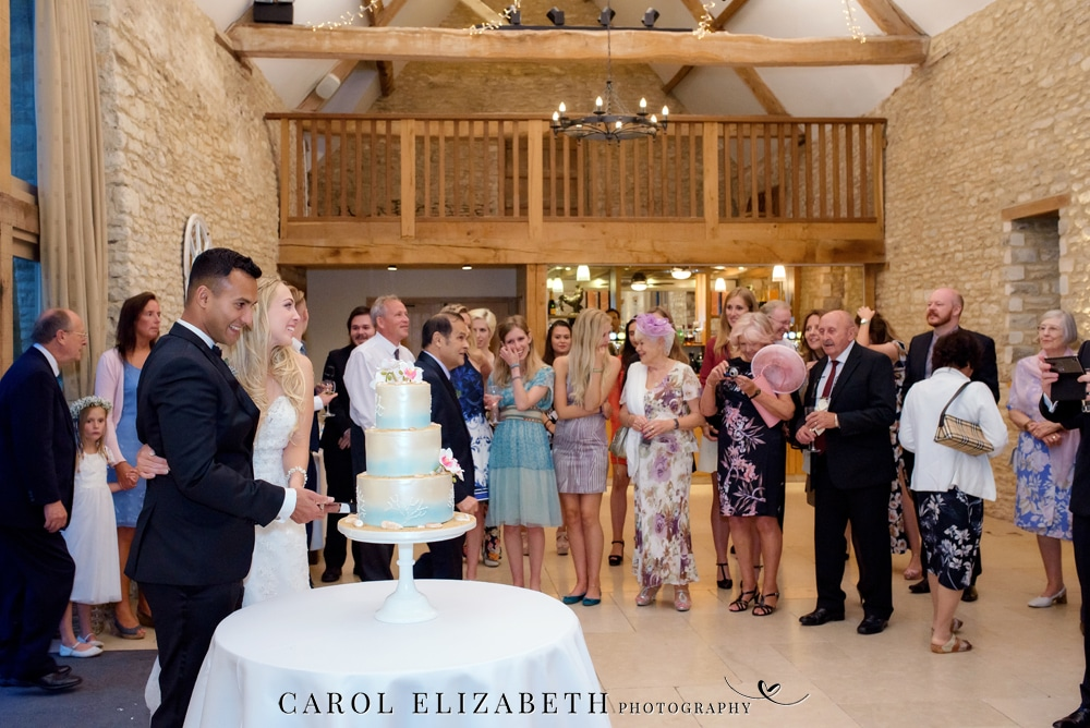Cutting the wedding cake at Caswell House