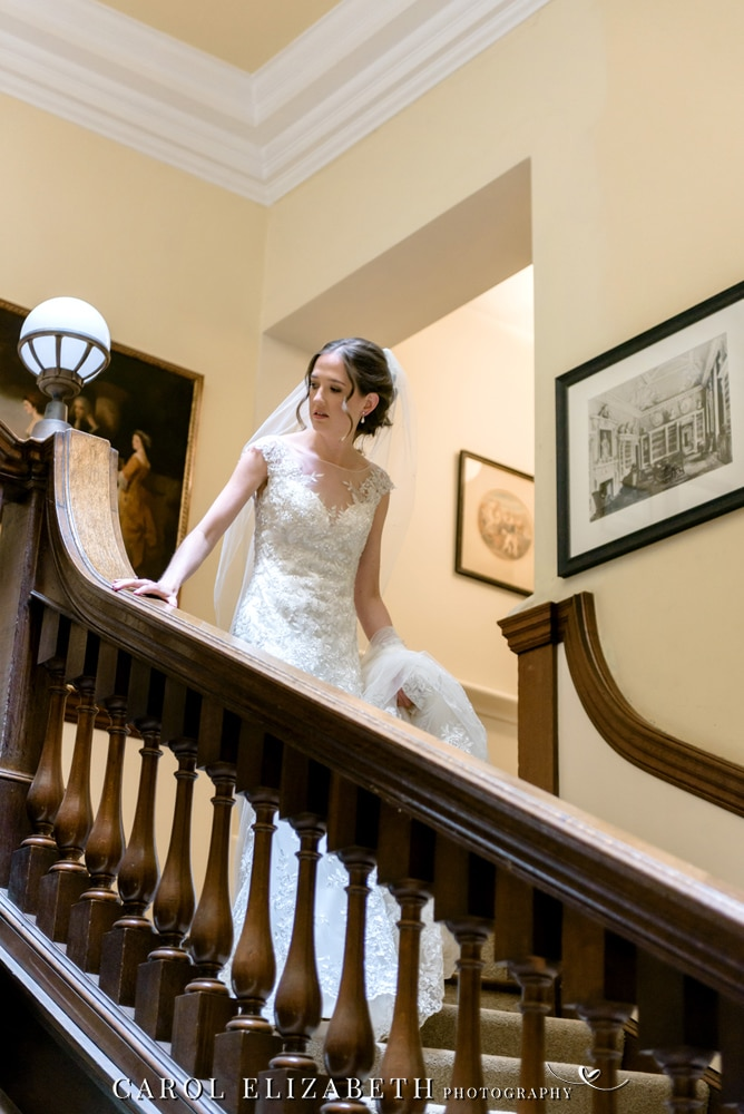 Bride on the staircase at Kirtlington PArk weddingBride on the staircase at Kirtlington PArk wedding