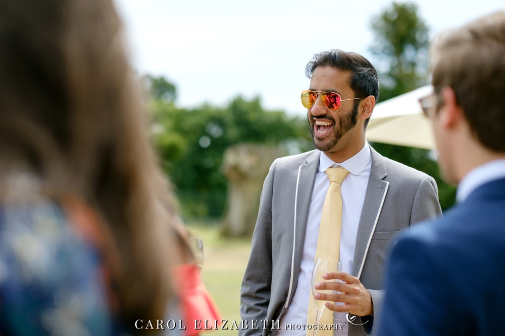 Natural wedding photo of guests at Kirtlington Park