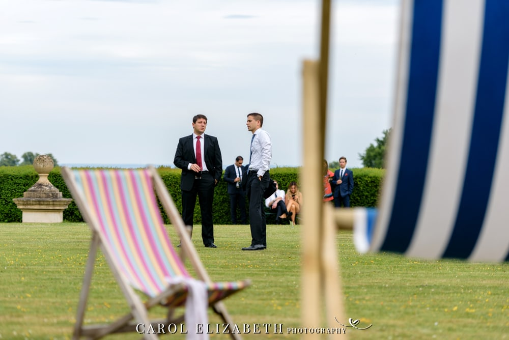 Guests and deck chairs on the lawn