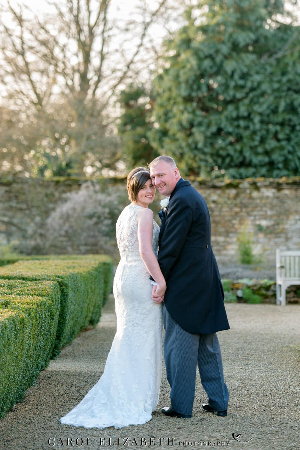 Caswell House winter weddings - bride and groom in the grounds