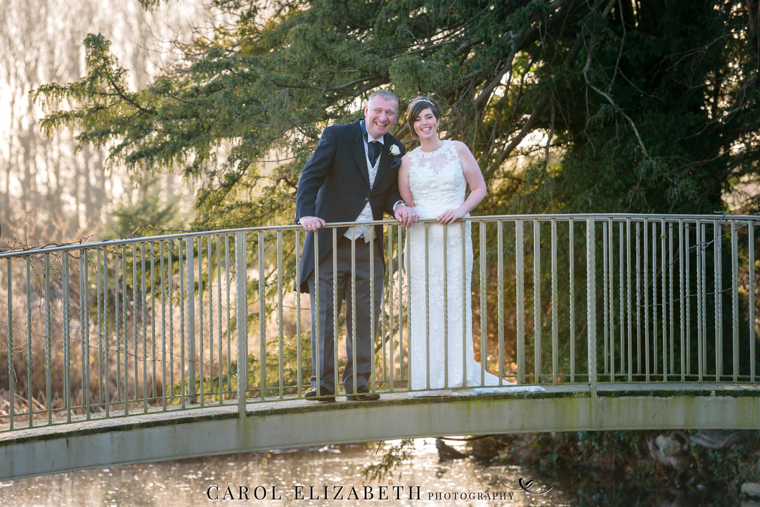 Caswell House winter wedding photography - photo on the bridge