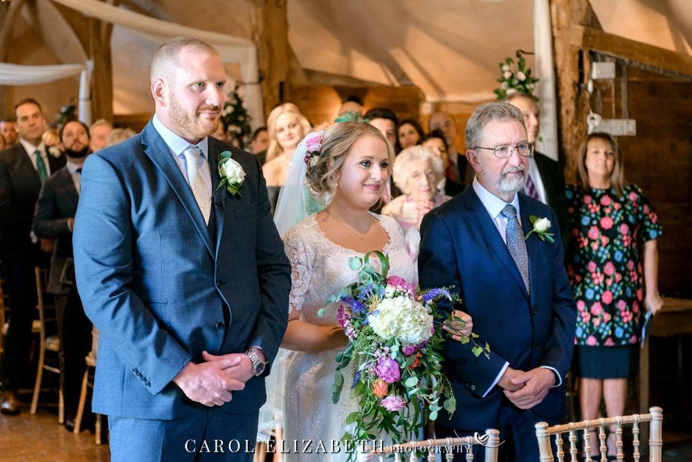 Natural and informal wedding photography at Lains Barn