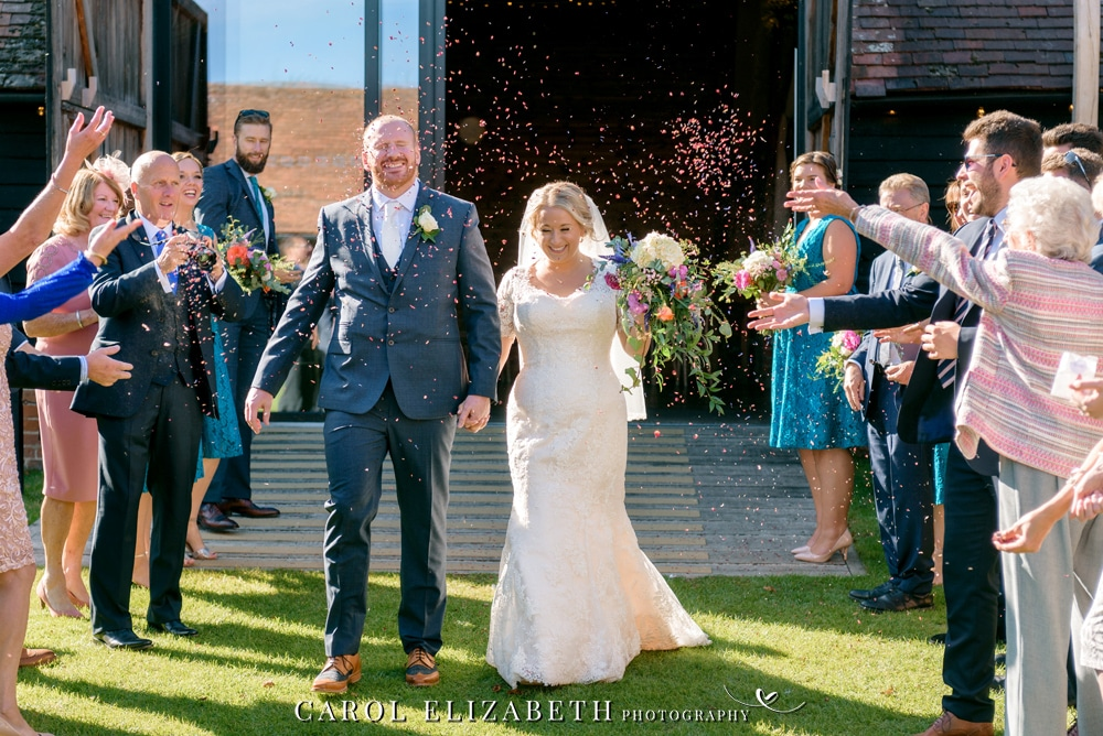Confetti at Lains Barn wedding - relaxed wedding photography