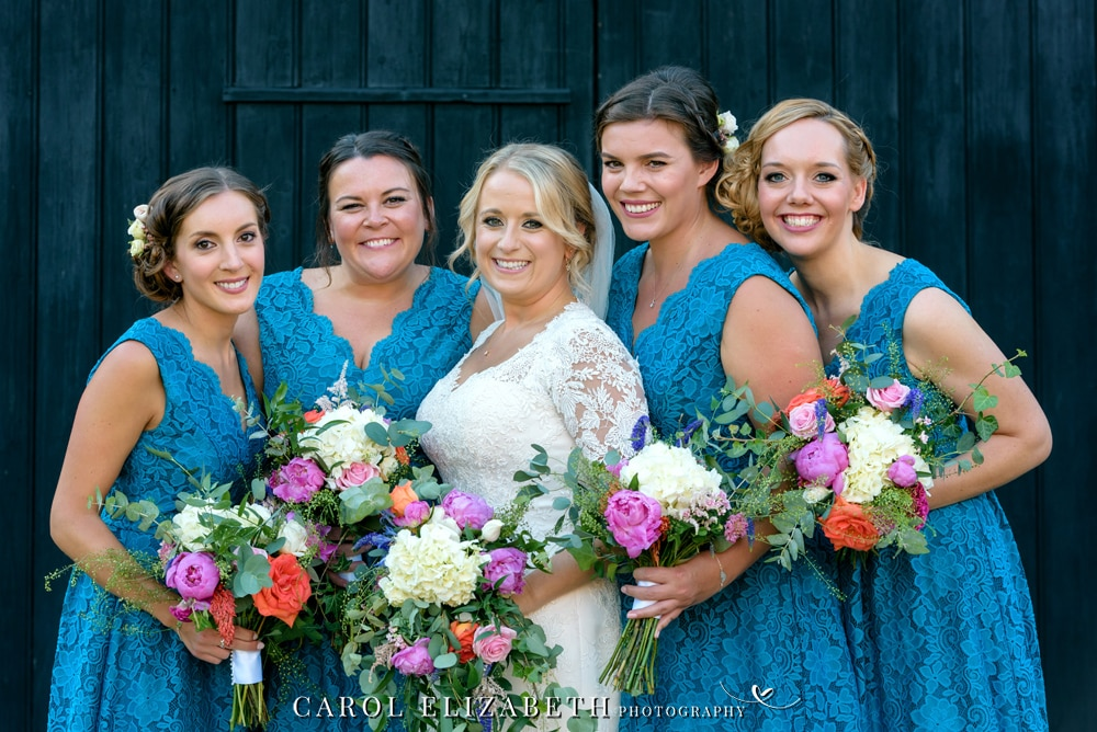 Wedding photography at Lains Barn on bride and bridesmaids