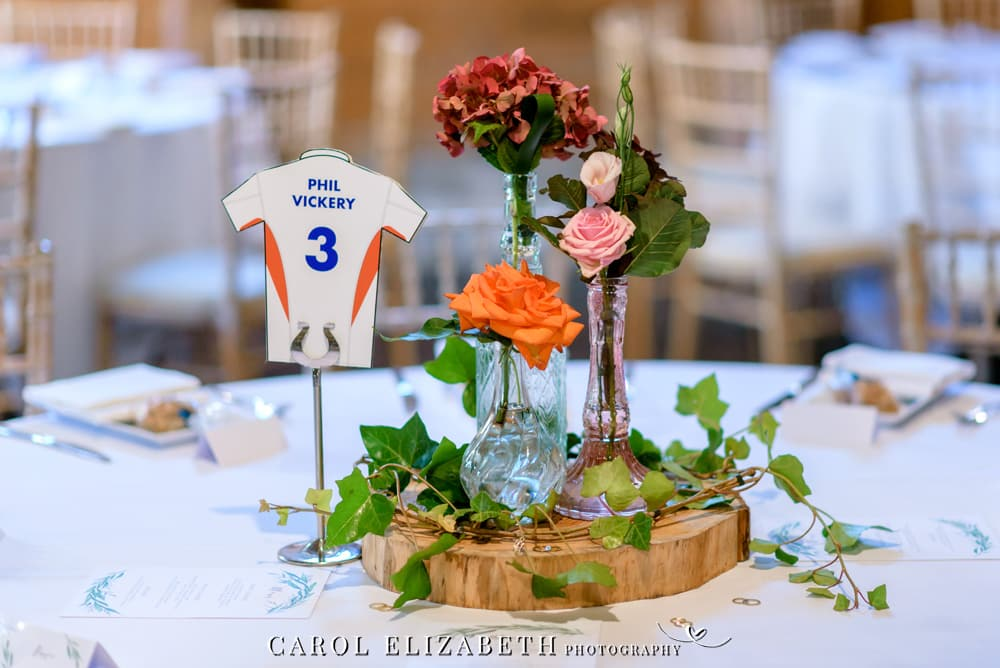 Table centre pieces with flowers in vases