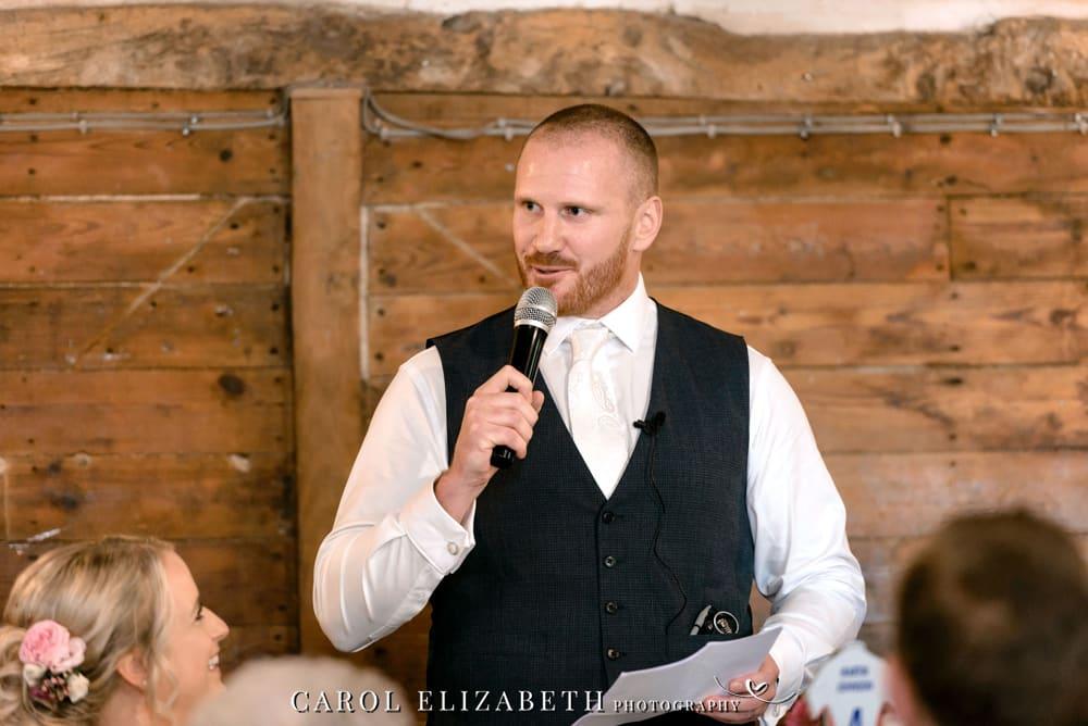 Lains Barn wedding photos of grooms speech
