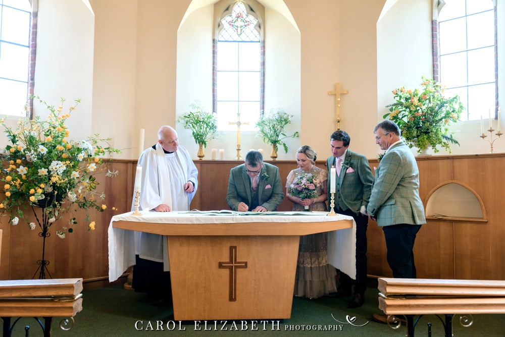 Hampshire wedding photography at Christ Church Hatherden. Stylish and romantic wedding photography in Hampshire