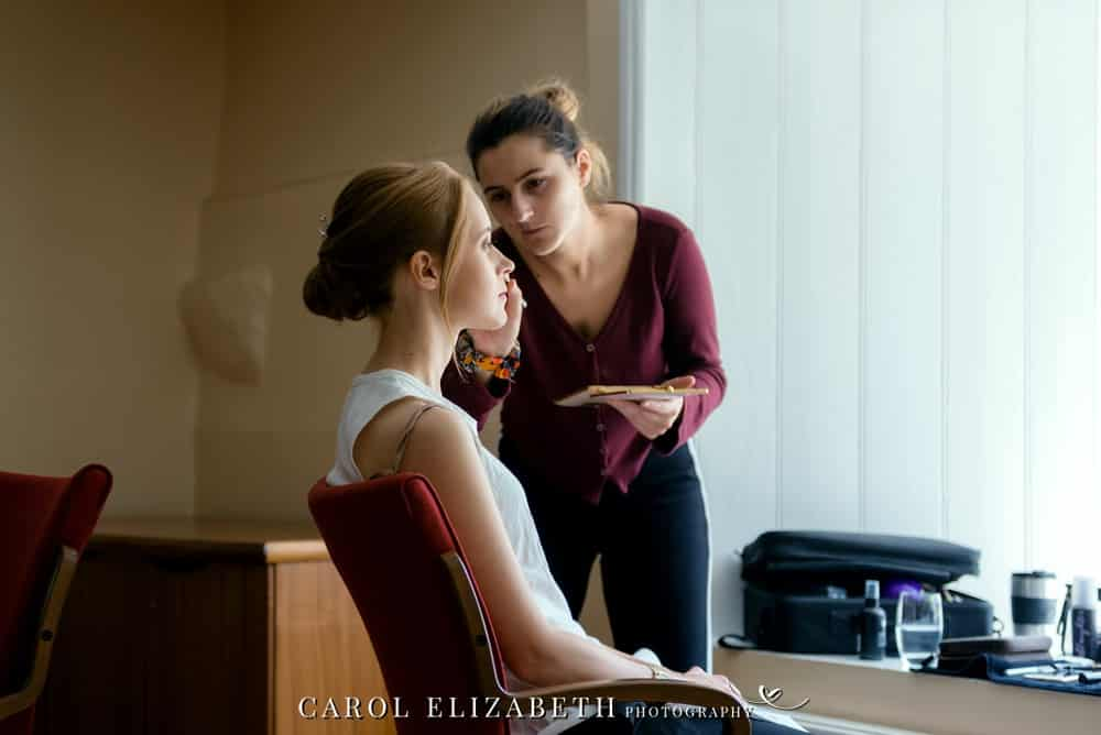 Bridal preparations hair and makeup before wedding ceremony