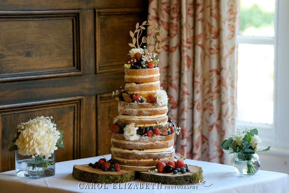 Wedding cake with fruit and flowers at Coseners House