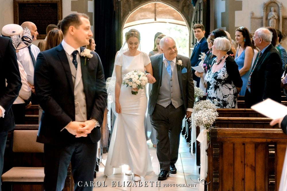 Bride and Dad walking down the church aisle